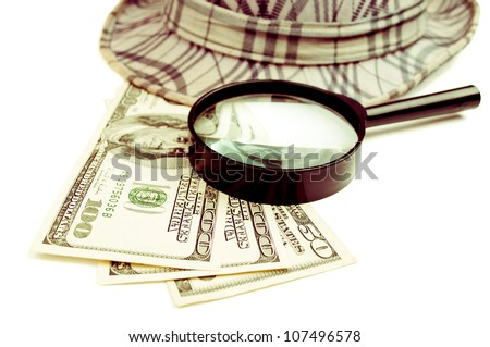 American Dollar-bills, magnifying glass and hat, isolated on white