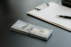 american dollar bills on wooden desk