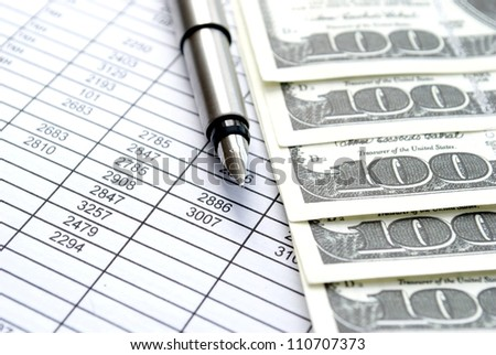 american dollars, and documents on the table
