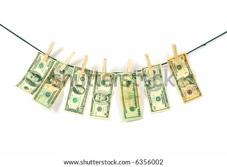 american dollars hung on a clothesline