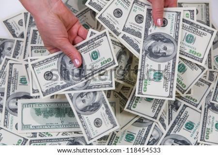 American dollars in a women hands.