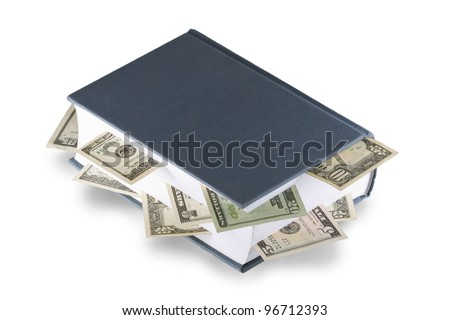 American dollars tucked between the pages of thick book