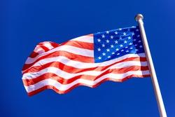 American Flag against blue sky.