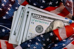American flag and banknotes USD currency money