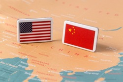 American flag and Chinese flag over world map