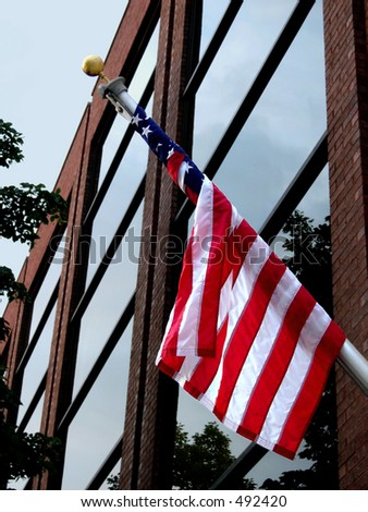 American flag and office building