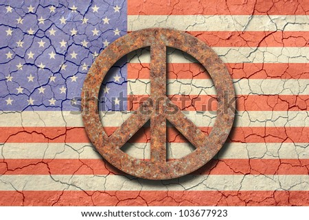 American flag background with an arid cracking soil appearance. Up front a rusty peace sign./ Cracking American Flag, Rusty Peace Symbol /  Great look, with a straightforward point of view.