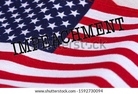 American Flag background with the word Impeachment in typed letters
