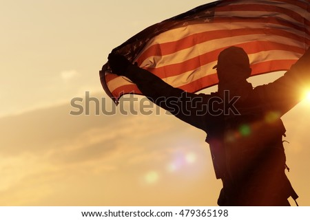 American Flag Celebration. Navy Soldier with United States of America Flag in Hands. Military Concept.