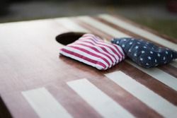 American Flag cornhole boards with bean bags with focus on the bean bags