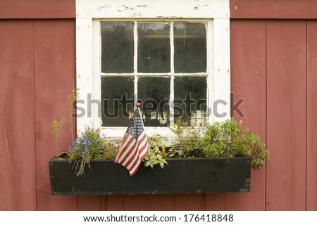 American flag displayed in flower pot of house window off of Manchester Road, St. Louis County, Missouri