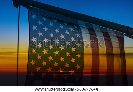 American Flag during an amazing soft sunset at the beach in America