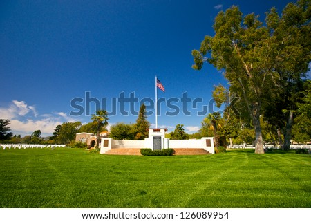 American flag flies high over Los Angeles National Cemetery.