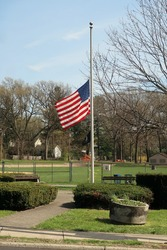 American flag flying at half mast.