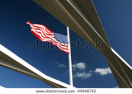 American flag flying on the Arizona Memorial at Pearl Harbor, Hawaii.