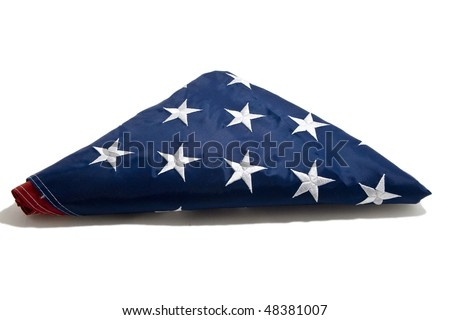American flag folded on white background