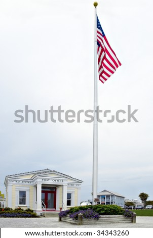 American flag in front of a post office in Seaside Florida USA