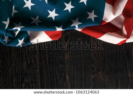 American flag on a antique wooden platform. #1063124063