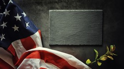 American flag on a black stone background. Space for text.
