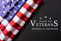 American flag on black background with text. Happy Veterans Day.