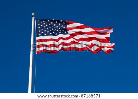 American flag on blue sky background