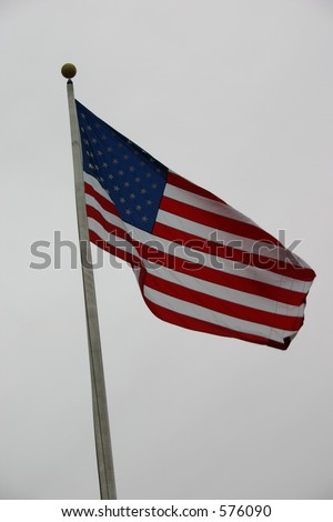 American Flag on gray day.