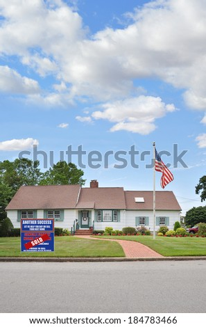 American Flag Real Estate Sold (another success let us help you buy sell your next home) sign suburban landscaped ranch style home brick walkway residential neighborhood usa blue sky clouds #184783466