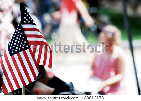 American flag show by people on 4th of july parade, god bless America