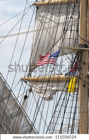 American Flag Surrounded by Rigging and Sails of a Tall Ship