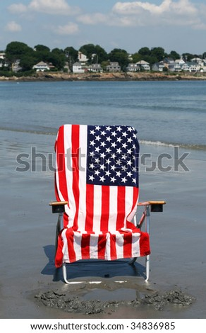 american flag towel on lounge chair at beach
