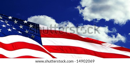 american flag waving against deep blue clouds background