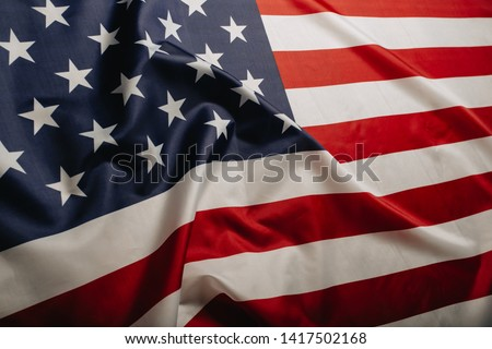 American flag waving in the wind.  #1417502168