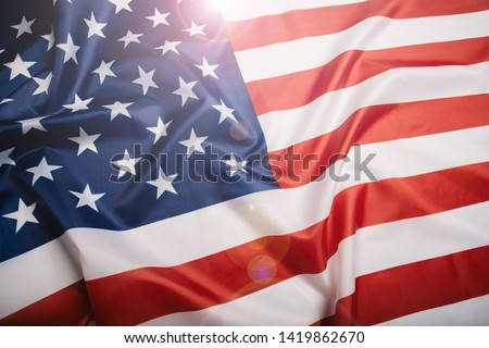 American flag waving in the wind.  #1419862670