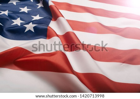 American flag waving in the wind.  #1420713998