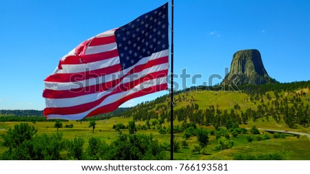 American Flag Waving Outside Devil's Tower in Wyoming, USA
