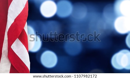 American Flag With Blue Bokeh Lights Background for United States Holidays #1107982172