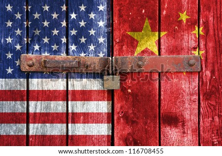 American flag with the China flag on the background of old locked doors