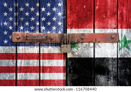 American flag with the flag of Syria on the background of old locked doors