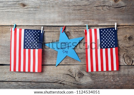 American flags and paper star with inscription Happy Inscription Day #1124534051