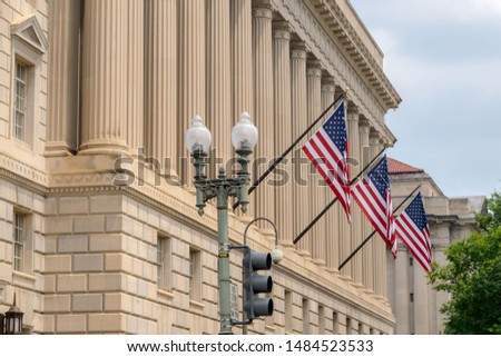 American flags hang from the exterior of a US federal government building