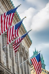 American Flags hanging from a building in Boston.