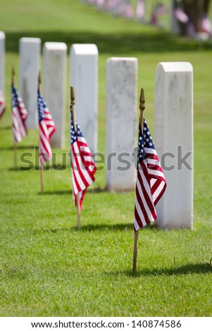 American flags on grave sites commemorate Memorial Day at a United States national cemetery.