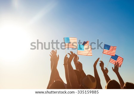 American flags. Patriots of America. Fans at the concert. People waved American flags. Fans meet idol.