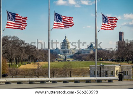 American Flags with US Capitol on background - Washington, D.C., USA #566283598