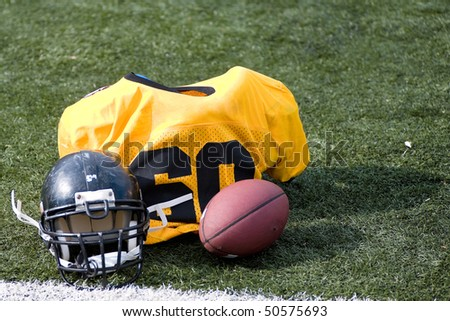american football equipement on fotball field