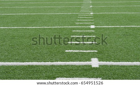 American football field of artificial turf with white markers.  Copy space.