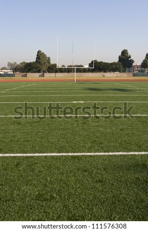 American football field with goal post in background