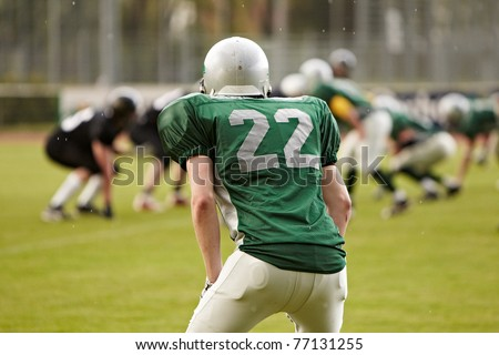 american football game with out of focus players in the background