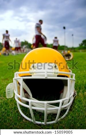 American football helmet in grass