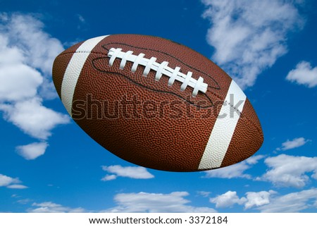 American football isolated over a cloudy sky background